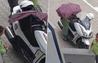 KIRIK ŞEMSİYESİYLE POLİS MOTOSİKLETİNİ YAĞMURDAN...